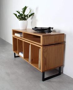 This solid wood, minimalist storage cabinet is designed for housing a vinyl record collection in style, but it can also be used as a sideboard, drinks cabinet or for multi media storage. Record Player Cabinet, Record Player Stand, Stereo Cabinet, Vinyl Record Storage, Lp Storage, Media Storage, Vinyl Shelf, Wood Storage Cabinets, Solid Wood Cabinets