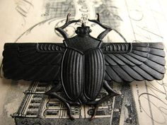 Egyptian scarab beetle with wings dark by FallenAngelBrass