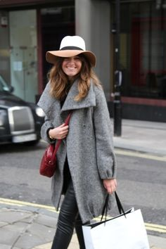 oversized jacket + skinnies and hat.