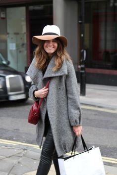 Shop this look on Lookastic:  http://lookastic.com/women/looks/hat-skinny-pants-crossbody-bag-turtleneck-coat/4576  — Khaki Wool Hat  — Black Leather Skinny Pants  — Burgundy Leather Crossbody Bag  — Black Turtleneck  — Grey Coat