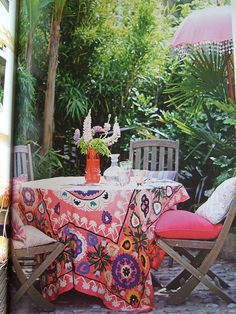 Suzani Tablecloth. I would love this as a big flowy, maxi-skirt! Or Curtains!