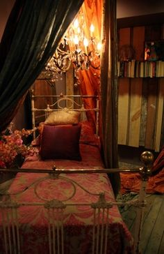 This is what you would call my dream room, Just add floor to sealing books and a huge window. <3