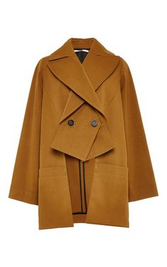 This double breasted **Rosetta Getty** trench coat is rendered in cotton viscose and features a structured fit with a wide notched lapel in a modern slashed design.