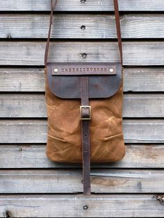 Waxed canvas day bag/small messenger bag with waxed brown leather strap,COLLECTION UNISEX. $79,00, via Etsy.