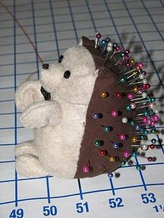 The cutest little pincushion!  Could you use a tiny teddy bear as the hedgehog body?