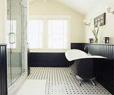 Adding Features Architectural details and interesting shapes keep a black-and-white palette from being boring. Black wainscoting adds elegance, black and white tiles lend graphic appeal, and the curvy black claw-foot tub is the jaw-dropper. Black Tub, Black White Bathrooms, Black And White Tiles, Black Bathtub, Black Wood, Bathroom Black, Bathroom Floor Plans, Bathroom Flooring, Attic Bathroom