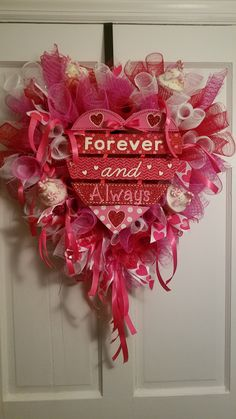 Valentine's Day Deco spiral wreath.  Center piece I got from the Dollar Tree Last season,  cupcakes ornaments I got after Christmas on sale.  Heart shape frame, pink white and red mesh with ribbon