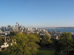 the city of Seattle with Mt Rainer in the background and Elliott Bay from Queen Anne hill's Kerry Park...see more info about Queen Anne as a great airbnb neighborhood stay follow the link.  #seattlewashington #glutenfree  #seattletravel  #discoveryparkseattle  #kayak  #seattlerestaurants