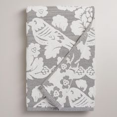 Woven in Portugal of absorbent cotton, our sculpted towel features a floral design with bird accents on a gray ombre background.