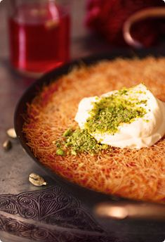 Kunefe - a Turkish dessert with Arabic orgins. It is made of a sweet, very fine vermicelli-like pastry and stuffed with cheese. It is most often topped with ice cream or a thick whipped cream.