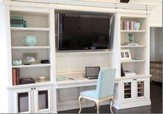 Built-in work space. Love the pops of turquoise against the white!