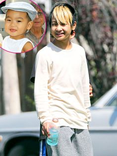 Maddox Jolie-Pitt (who belongs to Brad Pitt and Angelina Jolie)!  WOW! We are ALL getting old~ He's almost grown~!