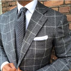 Gray flannel windowpane with gray striped tie.