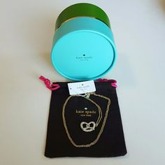 """Kate Spade Gold Pretzel Necklace Beautiful Kate Spade New York Gold Pretzel necklace dust bag and gift box. The necklace is 12 karat gold plated metal with glass stones as they sparkly salt, easy lobster claw closure  length: 32"""" and weight: 12.9g This handcrafted charming twist and shout necklace will be your favorite item. kate spade Jewelry Necklaces"""