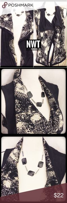 NWT Reversible Soft Knit Vest w sassy design Sassy reversible vest by westbound. This vest is a beautiful soft knit with sassy design embellishments in the fabric including ines of tan and blacks making it very versatile. NWT and ready to enjoy at a great price! Westbound Jackets & Coats Vests