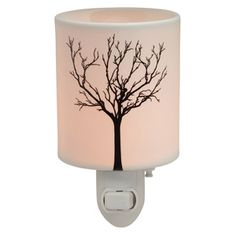 TILIA PLUG-IN SCENTSY WARMER A stark silhouette of winter-bare branches, backlit by a glowing porcelain base.