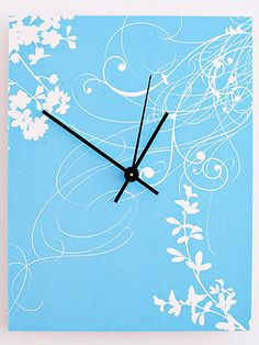 Decide on your clock's shape. Adhere paper to foam-core board using spray adhesive. Cut out the desired shape using a crafts knife.  If desired, paint chipboard numbers in a coordinating color; let dry. Attach to the clock face with glue.  Mark the location for the clockworks. Using a 5/16-inch-diameter dowel sharpened to a point (or a round pencil or awl), puncture a 5/16-inch hole. Carefully trim excess paper from the hole with a crafts knife.  Follow the manufacturer's instructions to att...