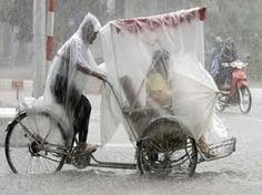 The Dutch amaze me with the many ways they come up with to stay dry on a bike.