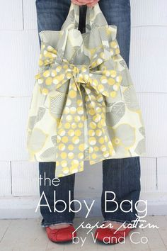 The Abby Bag Pattern by V and Co. Shipping only 91¢ for USPS First Class Mail. The Abby Bag is reversible and the bow can double as a light scarf! Finished Size: 15.5 x 17.5