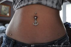 gaaahh,i want that belly button ring! wow.. hip piercings would hurt..