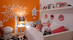 white tree in her closet for the reading nook to go with the orange wall paint