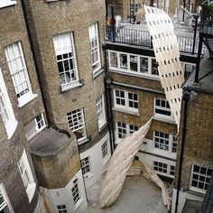 Students at the Architectural Association in London have constructed leaf-like sculptures that curl down from a fourth-floor roof terrace to a ground level courtyard