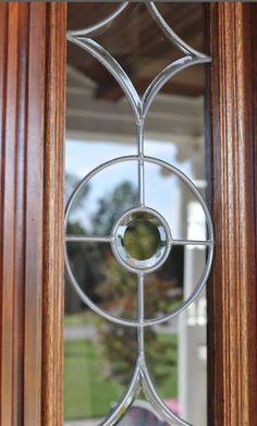 Custom reclaimed mahogany door. Refinishing by David Weis and Meridian Construction. #LouisvilleHomeBuilder #HomeBuildersLouisville #LouisvilleNewHomes #LouisvilleBuilders #Custom #HomeBuilderLouisville #LouisvilleCustomHomeBuilder #CustomHomeBuilder #CustomBuiltHomesLouisville #MeridianConstruction #NortonCommons #Homearama