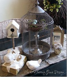 Spring vignette, bird house, bird cage,books, birds