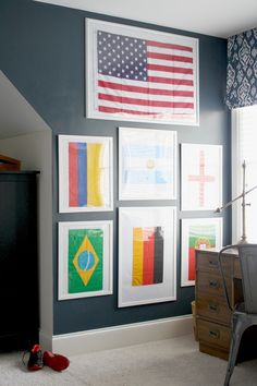 The Boys' Bedroom: soccer-theme with World Cup flags, framed, gallery wall, ikat roman shade, campaign desk, navy walls