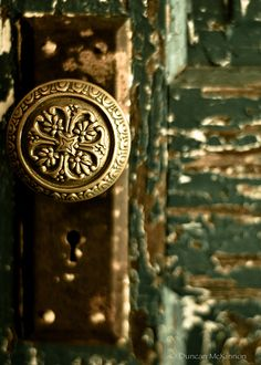 ornate doorknob + weathered wood | door hardware