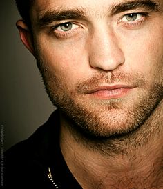 Robert Pattinson-assuming default position of drop dead gorgeous :-)