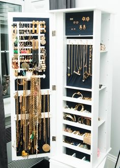 The Coveteur - closets - luxurious closet, jewelry cabinet, lined jewlery cabinet,  Lori Levine - Luxurious walk-in closet featuring jewelry