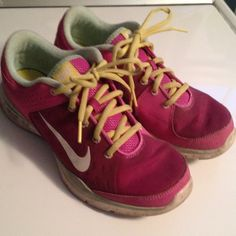 Nike shoes tennis running athletic shoes Pink yellow and minty greenish Nike shoes. Lots of life let to run jump bike or whatever in these shoes! Nike Shoes Athletic Shoes