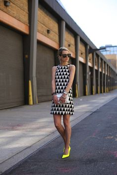 A geometric black and white dress with a neon heels add a POP of color! #colorful