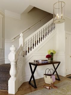 Dark geometric graphic stair runner with contrasting white woodwork