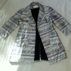 NEW PRICE Beautiful Nine West long jacket Victoria Beckham is trending long jackets in her Winter and Spring lines! Black and silver long lined jacket/coat with covered buttons. Perfect condition. Worn once to my son's Bar Mitzvah!  Perfect with black trousers. Jackets & Coats