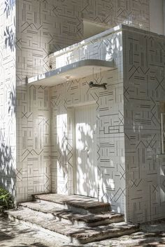 Entryway to Hueso Restaurant in Mexico including Bone Sign, love the tiles