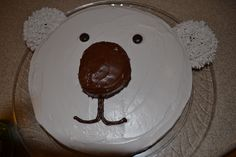 Koala cake - Cream filled oval shaped donut for nose. 12 inch skillet used for cake. Round donuts for ears, decorated with fur tip. Junior Mints for eyes.
