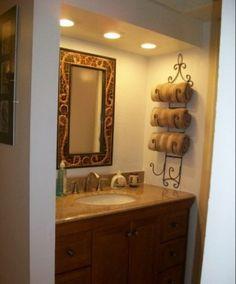 Use a wine rack as a towel holder :)