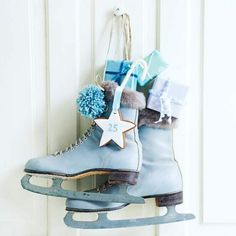 Who says you have to use a wreath to decorate the front door of your apartment for winter?  Why not use some festively embellished ice skates?