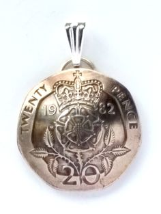 Beautiful pendants made from authentic coins from around the world!  Many countries and designs available, go to http://lamgallery.etsy.com/ to see more!!  New to lamgallery on Etsy: UK England Crowned Tudor Rose Coin Pendant Britain British English Coin Vintage Necklace Jewelry Unique Charm Foreign World FREE SHIPPING (20.00 USD)