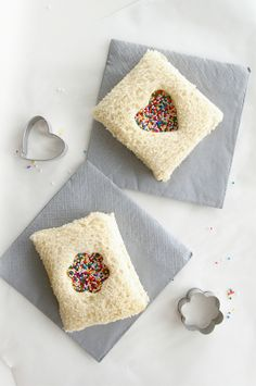 A sandwich-version of fairy bread - this uses pb or nutella (instead of butter), a dash of honey, & a dusting of sprinkles.  Love it.