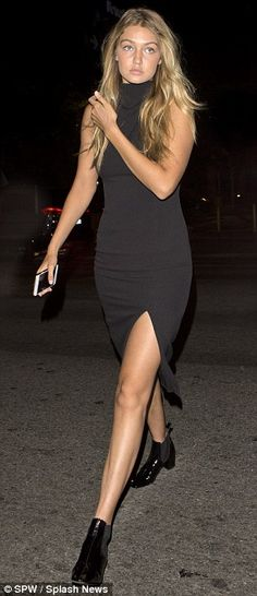 Casual but chic: Gigi, 20, looked gorgeous in a simple black midi dress which showcased he...