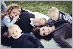 beautiful family photo taken in Layton, Utah of family laying on the ground looking up at the sky