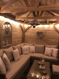 Homemade wooden gazebo, garden lights, outdoor sofa, outdoor seating, alfresco lounging