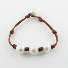 This is a beautiful and starkly simple bracelet design by Wendy Margot, the designer in Seaside, Florida who is credited with starting the trend of leather & freshwater pearl jewelry in the US.