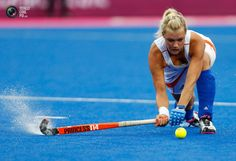 Netherlands' Sophie Polkamp reaches for the ball during their Group A hockey match against Japan at the London 2012 Olympic Games. DOMINIC EBENBICHLER/REUTERS