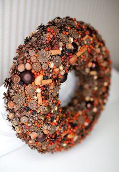This wreath is decorated with pine cones, cinnamon sticks, Briar fruit, acorns, Christmas ornaments.  External diameter- 33 cm (13) Internal