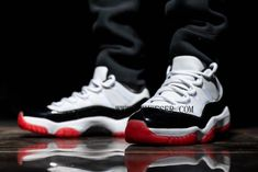 2020 Air Jordan 11 Low White Bred White University Red-Black-True Red AV2187-160  The Air Jordan 11 Low is sure to feature in the Jumpmans 2020 proceedings, with a rendition underpinned by a searing True Red sole recently appearing on the rumour radar. Dressed in a White, University Red, Black, and True Red color scheme. This Air Jordan 11 Low features a White leather upper with a Black patent leather mudguard atop a Red translucent outsole. Air Jordan 11 Low, Nike Air Jordan 11, Air Jordan Shoes, Air Jordans, Zapatos Air Jordan, Fresh Shoes, Air Max Sneakers, Nike Sneakers, True Red