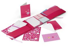 UNICEF New Blooms Correspondence Set by UNICEF. $19.00. Send a greeting, an invitation or simply keep in touch! Colorful paper, cards and stickers with bright, contemporary blooms in a ribbon-tie folder.